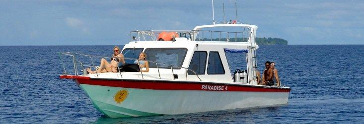 people on boat papua paradise
